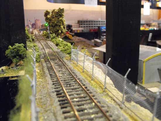 model railroad chainlink fences beside track
