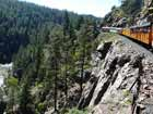 train by cliff