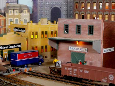 model railroad city at night