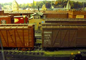 model railroad backdrop on cinder block wall