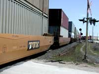 doublestack freight cars passing