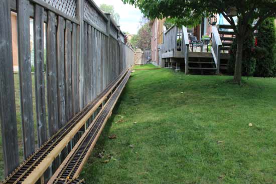 g scale mainline attached to fence