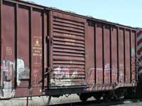 Boxcars with graffiti passing by north of Alliston, Ontario.
