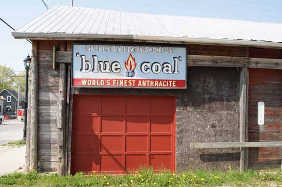 blue coal sign on original coal shed