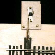 model train microswitch linkage