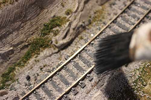 ballasting edges of model railroad track